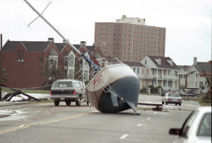 FILE - In this Sept. 22, 1989 file photo, a sailboat lies in the street of Charleston, S.C. after it was washed ashore by Hurricane Hugo. Twenty five years after the storm, Charleston Mayor Joseph P. Riley Jr., the longest-serving mayor in Charleston history, says preparing for and recovering from the storm was the most important time in his service to the city. Sunday. Sept. 21, 2014 is the 25th anniversary of Hugo's landfall. (AP Photo/Lou Krasky, File)